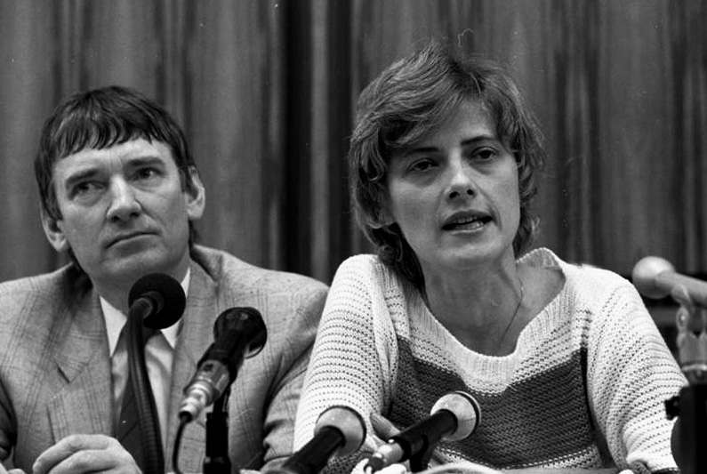 Otto Schily and Petra Kelly in front of microphones at a press conference.