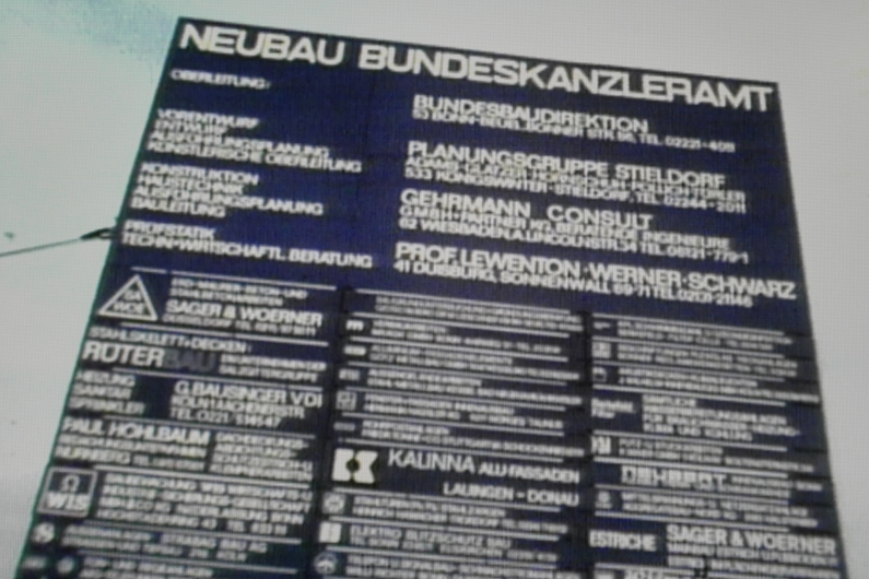 "Dark blue construction site sign with the inscription: ""New Federal Chancellery building"""