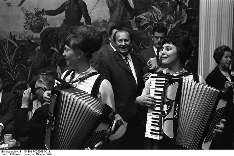 Two female accordion players performing